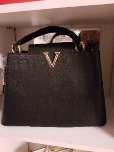Schwarze Handtasche kaufen